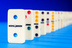 Dominoes lined up ready to be knocked over