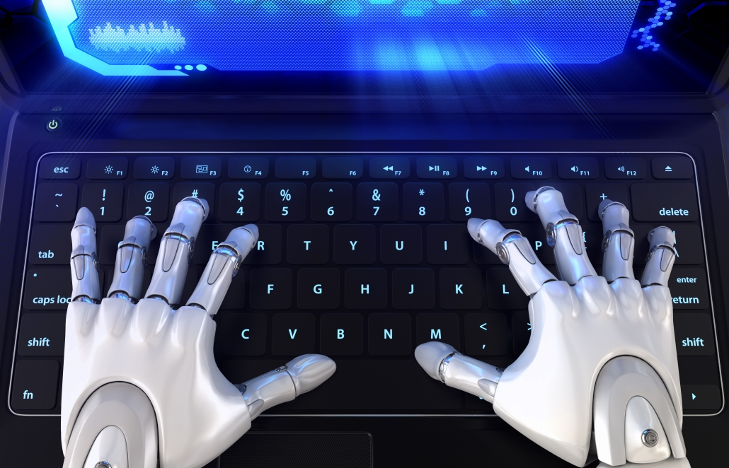 Robots hands typing a message on a keyboard.