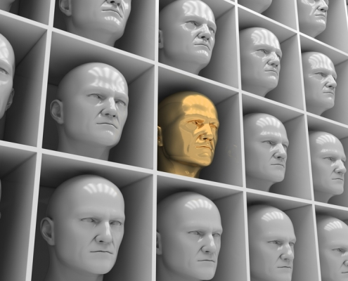 Many of the same people's heads in boxes. Uniformity, humanity, solitude