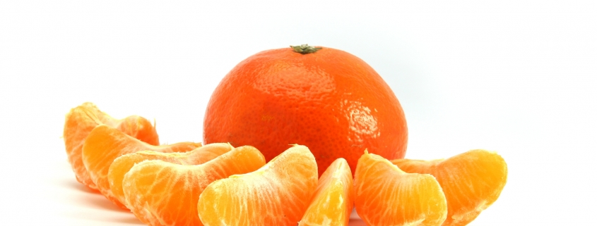 An Orange as a whole and divided into segments