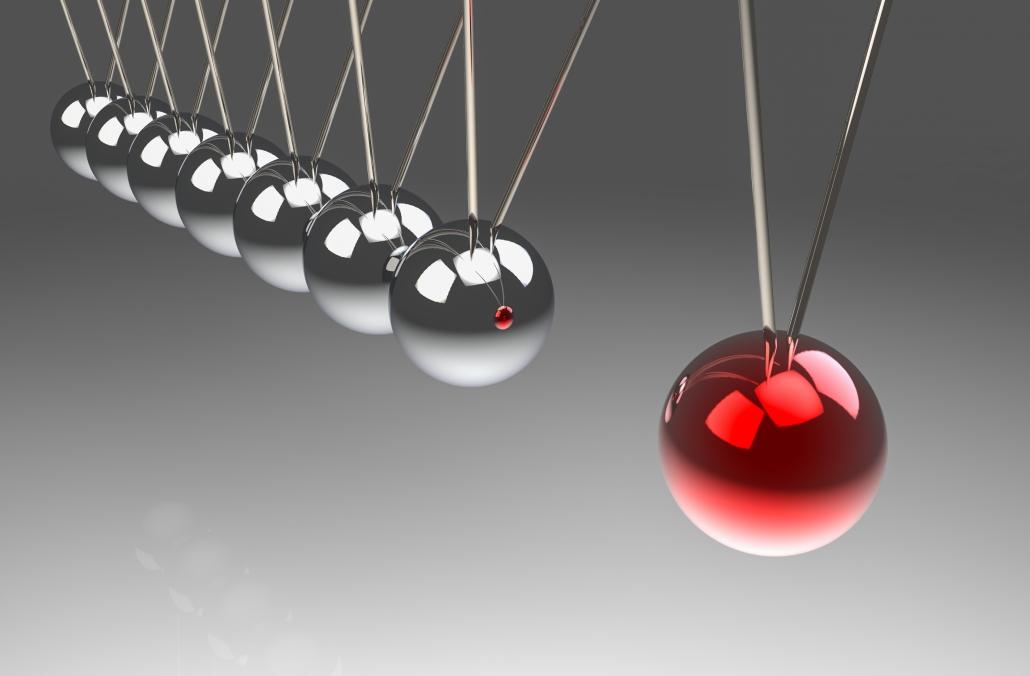 Momentum demonstrated by swinging pendulum